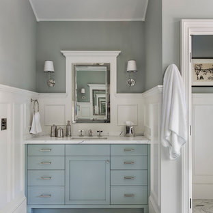 Mid-sized transitional master gray tile porcelain tile and multicolored floor bathroom photo in San Francisco with flat-panel cabinets, blue cabinets, a two-piece toilet, gray walls, an undermount sink and soapstone countertops