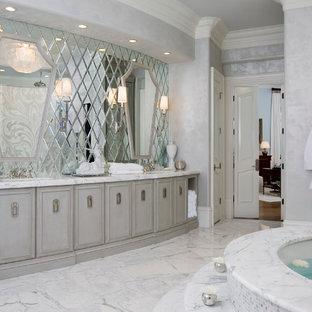 Bathroom - contemporary white tile bathroom idea in Atlanta with gray cabinets and an undermount tub
