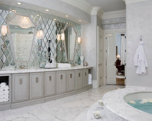 Contemporary White Tile Bathroom Idea In Atlanta With Gray Cabinets And An Undermount Tub
