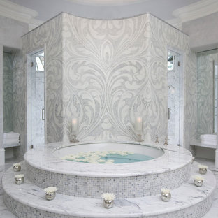 This is an example of a mediterranean bathroom in Atlanta with grey tiles, mosaic tiles and a hot tub.