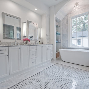 Bathroom - large transitional master white tile marble floor and gray floor bathroom idea in Atlanta with white cabinets, marble countertops, an undermount sink, white walls, recessed-panel cabinets and a hinged shower door