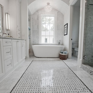 Bathroom - large transitional master gray tile and stone tile marble floor and gray floor bathroom idea in Atlanta with shaker cabinets, white cabinets, marble countertops, a two-piece toilet, an undermount sink, white walls and a hinged shower door