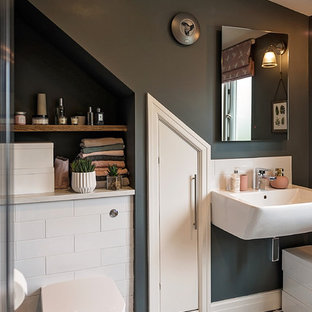 Small contemporary ensuite bathroom in Other with white tiles, porcelain tiles, grey walls, porcelain flooring, open cabinets, a one-piece toilet, a wall-mounted sink and multi-coloured floors.