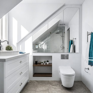 Photo of a mid-sized contemporary bathroom in Sydney with shaker cabinets, white cabinets, a one-piece toilet, white tile, ceramic tile, white walls, a vessel sink, brown floor and beige benchtops.