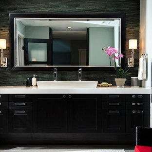 Trendy master black tile and matchstick tile porcelain floor bathroom photo in Atlanta with black cabinets, black walls and a trough sink