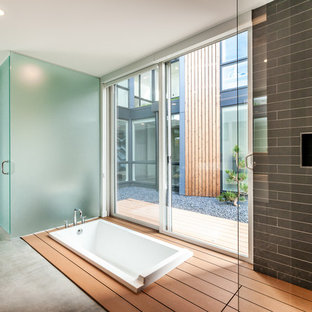 Inspiration for a contemporary drop-in bathtub remodel in Seattle