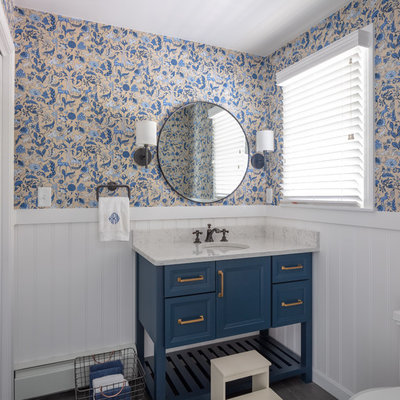 Inspiration for a coastal bathroom remodel in Boston with furniture-like cabinets, blue cabinets, multicolored walls, an undermount sink and white countertops