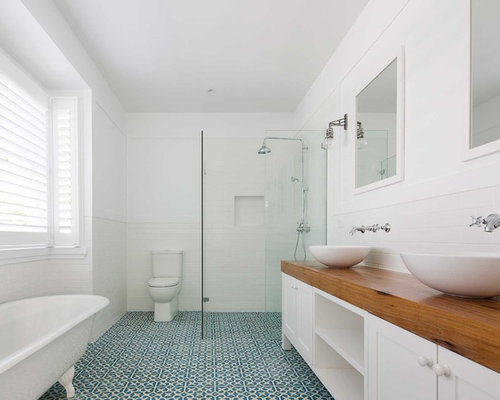 This is an example of a mid-sized beach style master bathroom in Sydney with