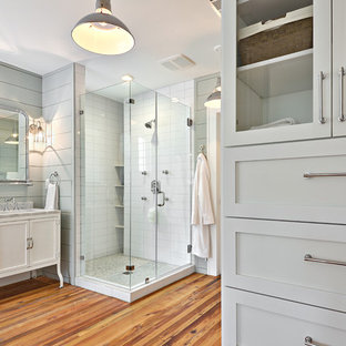 Bathroom - large transitional master medium tone wood floor bathroom idea in Austin with marble countertops, blue walls, shaker cabinets and white cabinets