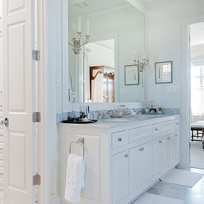 Inspiration for a large timeless master gray tile, white tile and stone tile marble floor drop-in bathtub remodel in Dallas with raised-panel cabinets, white cabinets, a one-piece toilet, white walls, an undermount sink and marble countertops