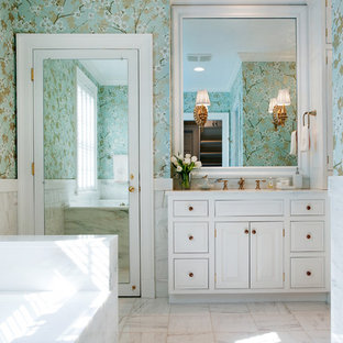 This is an example of a mid-sized traditional bathroom in Nashville with raised-panel cabinets, white cabinets, white tile, an undermount sink, marble benchtops, a drop-in tub, an alcove shower, marble floors and multi-coloured walls.