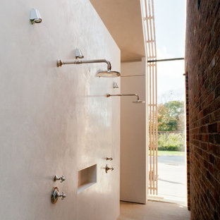 Inspiration for a modern double shower remodel in Other with white walls