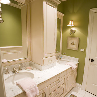Inspiration for a timeless bathroom remodel in Chicago with an undermount sink, raised-panel cabinets and beige cabinets