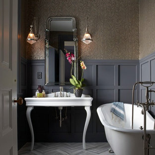 Mid-sized ornate 3/4 laminate floor claw-foot bathtub photo in Boston with gray walls and a console sink