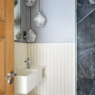 Inspiration for a small contemporary ensuite bathroom in London with flat-panel cabinets, white cabinets, a corner shower, white tiles, porcelain tiles, porcelain flooring, solid surface worktops, grey floors, a hinged door, a single sink and a floating vanity unit.