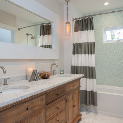 Example of a transitional white tile and stone tile bathroom design in Orange County with an undermount sink, medium tone wood cabinets, flat-panel cabinets and marble countertops