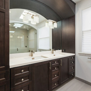 Bathroom - large traditional master porcelain floor bathroom idea in San Francisco with an undermount sink, recessed-panel cabinets, dark wood cabinets, white walls and engineered quartz countertops