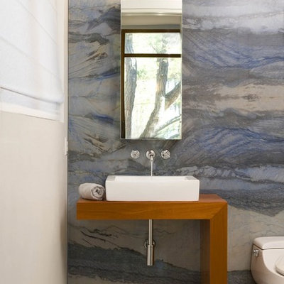 Bathroom - contemporary blue tile and stone slab bathroom idea in DC Metro with wood countertops and brown countertops
