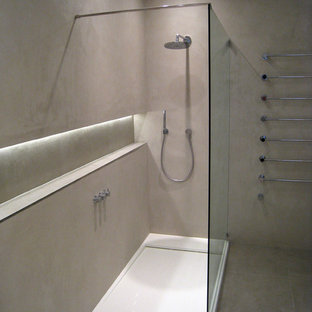 This is an example of an expansive contemporary bathroom in London with grey walls.