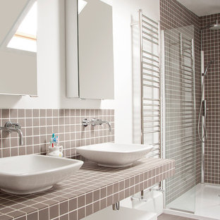 Medium sized contemporary bathroom in London with open cabinets, a corner shower, brown tiles, mosaic tiles, a vessel sink, grey floors, white walls, a hinged door and brown worktops.