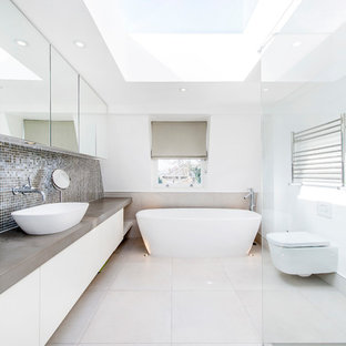 Inspiration for a contemporary bathroom in London with a freestanding tub.