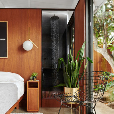 Example of a small trendy master black tile and ceramic tile concrete floor and gray floor bathroom design in San Francisco with flat-panel cabinets, medium tone wood cabinets, a wall-mount toilet, black walls and a pedestal sink