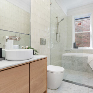 Design ideas for a contemporary wet room bathroom in Sydney with flat-panel cabinets, light wood cabinets, an alcove tub, white tile, a vessel sink, white floor, white benchtops, a single vanity and a built-in vanity.