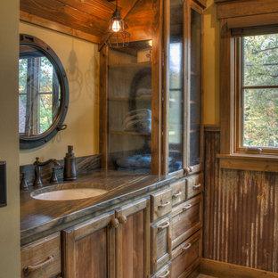 Bathroom - mid-sized rustic 3/4 dark wood floor and brown floor bathroom idea in Minneapolis with recessed-panel cabinets, dark wood cabinets, brown walls, an undermount sink and granite countertops