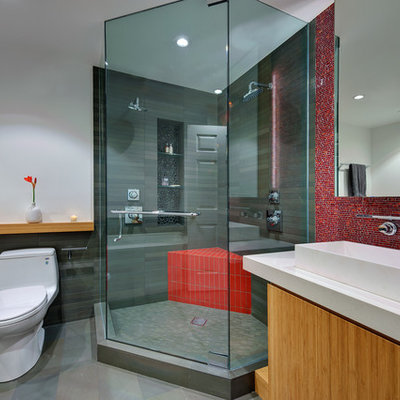 Corner shower - small modern 3/4 mosaic tile and red tile porcelain tile and gray floor corner shower idea in San Francisco with a vessel sink, open cabinets, a two-piece toilet, white walls, a hinged shower door, light wood cabinets and quartz countertops