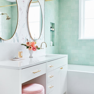 Bathroom - small transitional 3/4 green tile and ceramic tile ceramic floor and white floor bathroom idea in San Francisco with white cabinets, white countertops, flat-panel cabinets, multicolored walls and an undermount sink