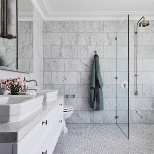 Photo of a transitional master bathroom in Newcastle - Maitland with recessed-panel cabinets, white cabinets, a curbless shower, marble, grey walls, a vessel sink, marble benchtops, an open shower, grey benchtops, a double vanity and a floating vanity.