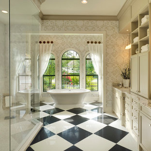 Elegant master white tile freestanding bathtub photo in Tampa with recessed-panel cabinets, beige cabinets, multicolored walls and an undermount sink