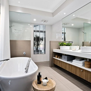 Large contemporary master bathroom in Perth with a freestanding tub, an alcove shower, beige walls, ceramic floors, a vessel sink, brown floor, an open shower, white benchtops, open cabinets, medium wood cabinets and brown tile.