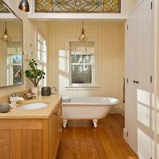 Farmhouse Bathroom by Phinney Design Group