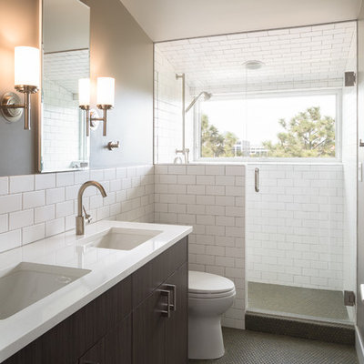 Mid-sized transitional master white tile and ceramic tile mosaic tile floor and gray floor alcove shower photo in Denver with flat-panel cabinets, dark wood cabinets, gray walls, an undermount sink, quartz countertops, a hinged shower door, a two-piece toilet and white countertops