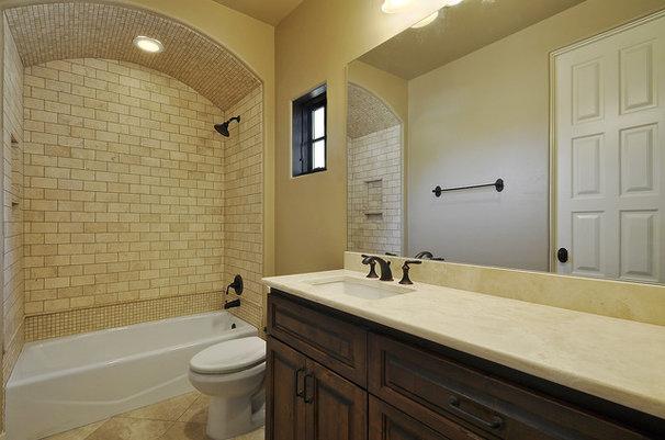 Mediterranean Bathroom by Capstone Custom Homes
