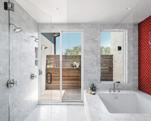 inspiration for a large contemporary master wet room remodel in austin with an undermount tub save photo allison burke interior design