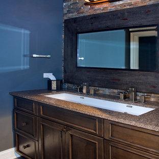 Ejemplo de cuarto de baño con ducha, clásico, grande, con armarios con paneles empotrados, puertas de armario marrones, ducha empotrada, paredes azules, suelo de cemento, lavabo de seno grande, encimera de cuarzo compacto, baldosas y/o azulejos multicolor y baldosas y/o azulejos de cerámica