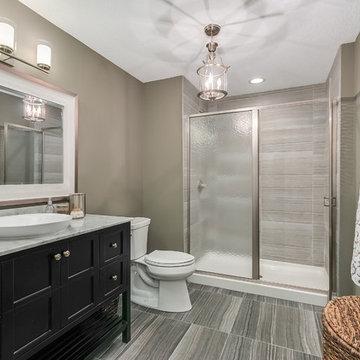 Basement Bathroom with Gray Tile