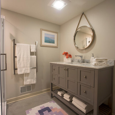 Example of a small transitional 3/4 gray floor and linoleum floor doorless shower design in Detroit with furniture-like cabinets, gray cabinets, gray walls, an undermount sink, marble countertops, a hinged shower door and gray countertops