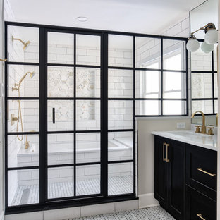 Example of a large minimalist master white tile and subway tile mosaic tile floor tub/shower combo design in New York with shaker cabinets, black cabinets, an undermount tub, a one-piece toilet, white walls, an undermount sink, a hinged shower door and white countertops