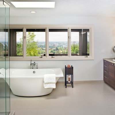Inspiration for a large contemporary master multicolored tile and glass tile ceramic tile bathroom remodel in Boise with a drop-in sink, flat-panel cabinets, dark wood cabinets, limestone countertops and gray walls