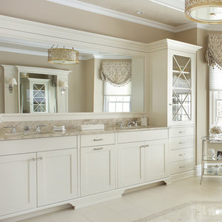 Inspiration for a large timeless master limestone floor and white floor freestanding bathtub remodel in New York with recessed-panel cabinets, white cabinets, beige walls, an undermount sink and granite countertops