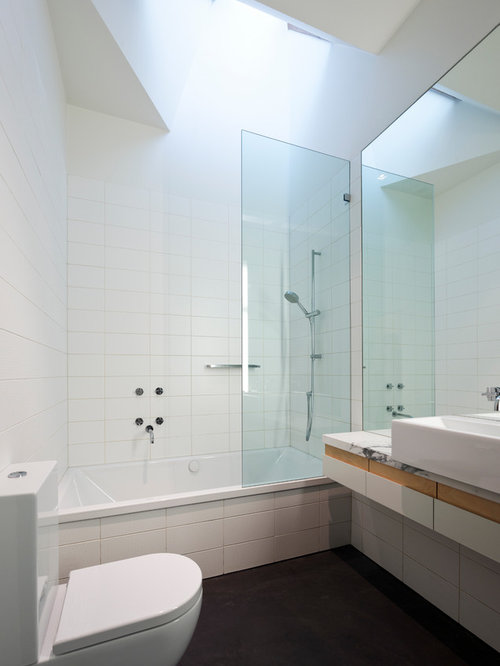 Example Of A Small Trendy White Tile And Porcelain Tile Concrete Floor  Bathroom Design In Melbourne