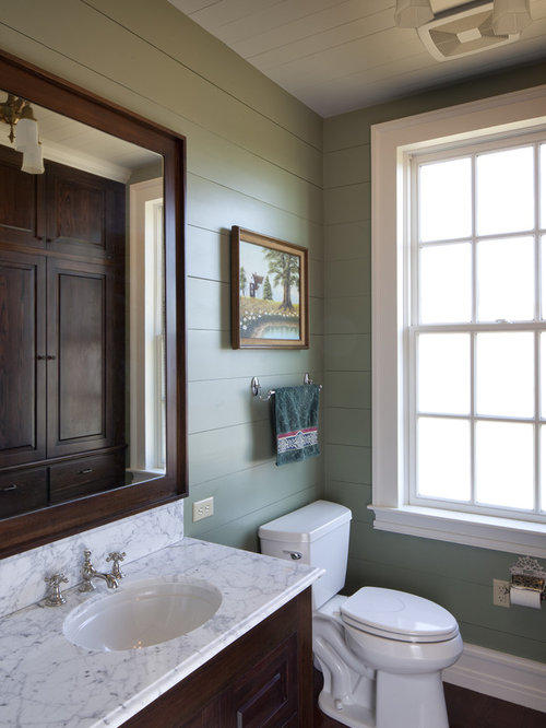 Mountain style bathroom photo in Austin with an undermount sink,  raised-panel cabinets,