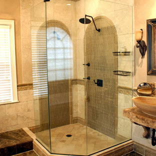 Photo of a mediterranean bathroom in Birmingham with a corner shower, a vessel sink, brown floors and travertine tiles.