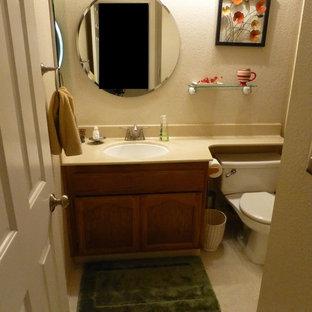 Imagen de cuarto de baño infantil, contemporáneo, pequeño, con lavabo bajoencimera, armarios con paneles empotrados, puertas de armario de madera oscura, encimera de granito, bañera empotrada, combinación de ducha y bañera, baldosas y/o azulejos beige, baldosas y/o azulejos de cerámica, paredes beige y suelo de linóleo
