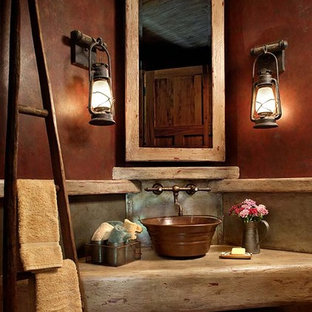 This is an example of a traditional bathroom in Other with concrete benchtops and red walls.