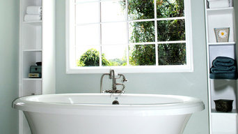 Bath featuring freestanding tub framed by built-in shelves