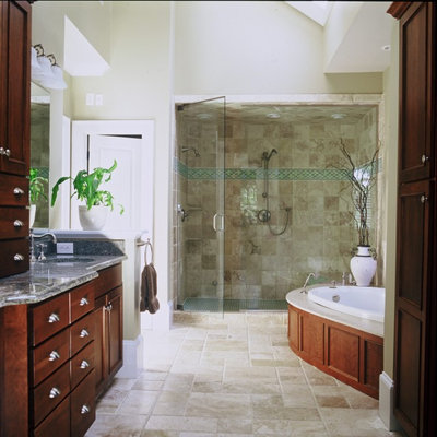 Inspiration for a contemporary beige tile bathroom remodel in Atlanta with an undermount sink, flat-panel cabinets and dark wood cabinets